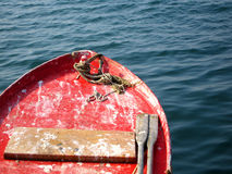 Weathered red rowing boat Stock Images