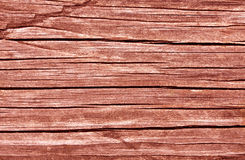 Weathered red toned wooden board texture Royalty Free Stock Photography
