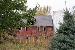 Weathered red barn with silo royalty free stock image