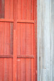 Weathered Red Wooden Door on Wooden Outbuilding. Weathered Red Wooden Door on Old Wooden Outbuilding Stock Photo