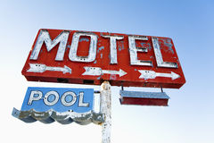 Weathered Retro Motel Sign. Old weathered retro neon motel sign advertising pool and vacancy. Horizontal shot Royalty Free Stock Image