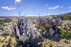 Weathered rock formations and wind turbines - renewable energy and earth conservation concept. Royalty Free Stock Image