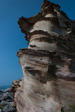Weathered rocks. With a blue sky in summer Stock Images