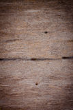 Weathered rough textured old plywood background Stock Image
