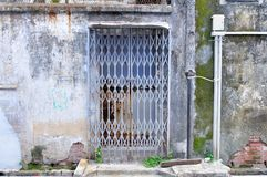 Weathered. Rusted back door, gate and wall Stock Image
