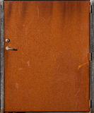 Weathered rusted metal door Royalty Free Stock Images