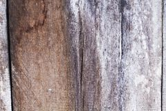 Weathered rustic wooden photo texture. Winded timber table with drips. Shabby chic backdrop in grey and brown colors. Raw lumber board with cracks. Obsolete Stock Images