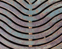 Storm Drain Rusty Grate. Cast iron grate over a drain with a screw head Stock Photography