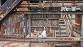 Rusty industrial scenery. Weathered rusty industrial scenery with old corroded steel girders Royalty Free Stock Image
