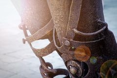 Weathered rusty metal element on the street, shaped detail closeup. Grunge rusty metal texture. Rough dirty surface of metal decoration royalty free stock image