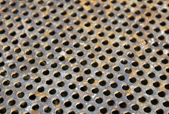 Weathered rusty metal surface with holes and blur effect Royalty Free Stock Images