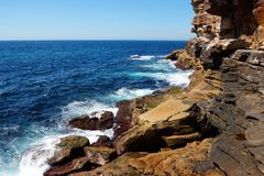 Weathered Sandstone Cliffs and Ocean Royalty Free Stock Image