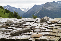 Weathered shingle roof in Italy. Weathered shingle roof in the Italian alps Royalty Free Stock Photos