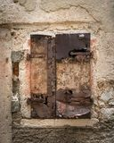 Weathered shutter and window of a stone house in Cres. Croatia stock image