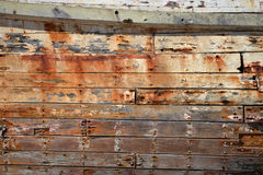 Weathered side of old ship. Time and weather have given this old shipwreck character royalty free stock image