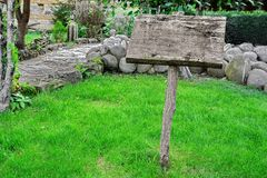 Weathered  Signpost Board  on the Grass Area Stock Images