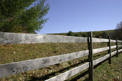 Weathered Split Rail Fence. That surrounds a pastoral landscape Stock Photos