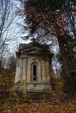 A weathered spooky crypt in the forest late autumn.  Stock Photos