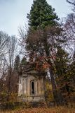 A weathered spooky crypt in the forest late autumn.  Royalty Free Stock Image