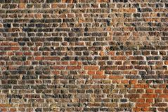 Weathered stained old brick wall background Stock Photos