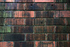 Weathered stained old brick wall background. Royalty Free Stock Photos