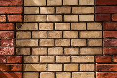 Weathered stained old brick wall background Royalty Free Stock Image
