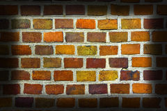 Weathered stained old brick wall background. Royalty Free Stock Image