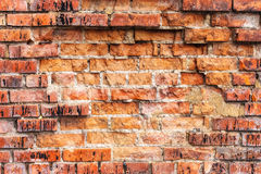 Weathered stained old orange brick wall, texture grunge background Stock Photo