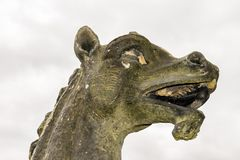 A weathered stone dragon`s head outside royalty free stock photography