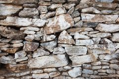 Weathered stone painted wall texture from Greece royalty free stock images