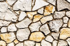 Weathered stone wall as background texture royalty free stock photos