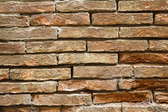 Weathered stone wall, textured background Stock Images