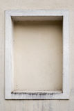 Weathered stucco wall with a stucco frame Royalty Free Stock Image