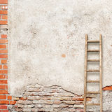 Weathered stucco wall with wooden ladder Royalty Free Stock Photography