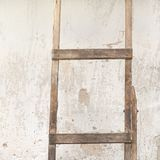 Weathered stucco wall with wooden ladder royalty free stock photos