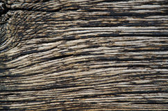 Weathered tarred wooden background. With a rustic texture Stock Photo