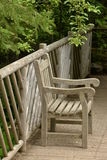 Weathered teak chair Metis Gardens Grand Metis Stock Photos