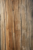 Weathered Telephone Pole. Closeup of the weathered surface on a wooden telephone pole. Vertical shot Royalty Free Stock Images