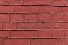 Weathered terracotta brickwork of the old building with bulging seams. Part of the wall Stock Images