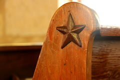 Weathered Texas star on church pew, San Antonio. stock image