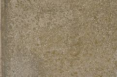 Weathered textured gray surface of the artificial stone. Flat aged surface of artificial stone made of mixture of mortar and small white marble pieces. Gray stock photography