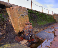 Weathered tidal pool pump. Old tidal pool pump weathered by the elements Royalty Free Stock Photography