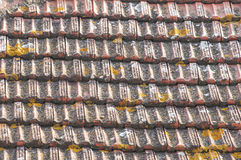 Weathered tiles of house roof stock images