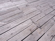 Weathered timber planks at a pier backdrop Royalty Free Stock Image
