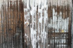 Weathered timber wall and door. Painted and weathered timber wall with rustic door Stock Image