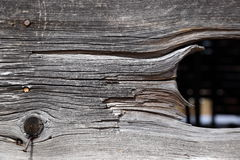 Weathered tobacco barn board with gap revealing dark space behind Stock Images