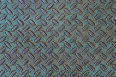 Weathered treadplate background with blue-green patina Stock Images