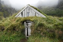 Weathered turf house. Original and weathered wooden turf house with grass roof Royalty Free Stock Images