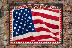 Weathered US flag inside a vintage metal frame Stock Photography
