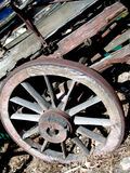 Weathered wagon wheel. An old weathered wagon wheel on the side of a wagon Royalty Free Stock Photos
